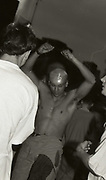 Shirtless man dancing at the first outdoor rave up North, The Gio Goi Joy Rave run by Anthony and Chris Donnelly, Ashworth Valley, Rochdale, 5th August 1989.