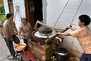 Neighbors of widowed farmer Lan Guihua make soymilk with a hand-powered stone mill at their home in Ganjiagou Village,  Sichuan Province, China. (Lan Guihua is featured in the book What I Eat: Around the World in 80 Diets).