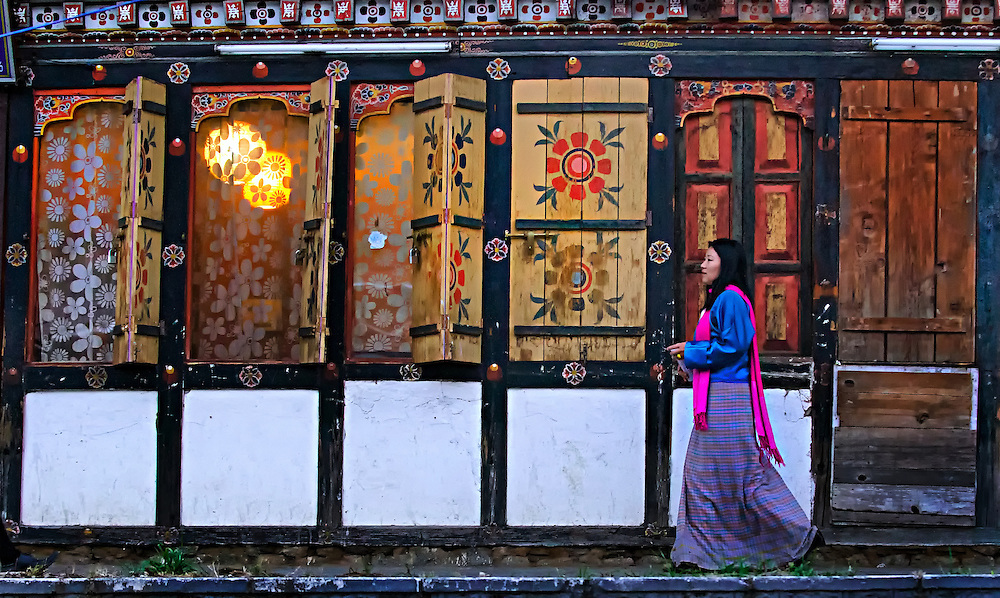 A woman walking down a street in Thimphu, Bhutan.