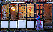 A woman walking down a street in Thimphu, Bhutan.