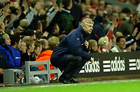 Photo: Paul Greenwood.<br />Liverpool v Arsenal. The FA Cup. 06/01/2007. Arsenal manager Arsene Wenger adopts a strange position