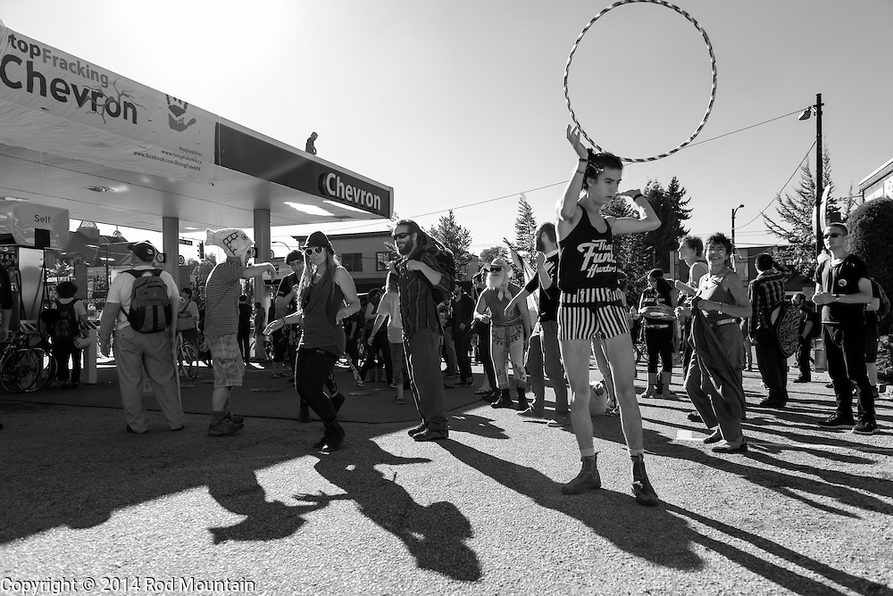 Vancouver, BC, Canada - September 27, 2014 - The protesters have overtaken the Chevron gas station and begun dancing during the &quot;Party Against the Pipelines&quot; Protest in Vancouver, B.C.<br /> <br /> Photo: &copy; Rod Mountain<br /> <br /> http://www.rodmountain.com<br /> <br /> @rod_mountain