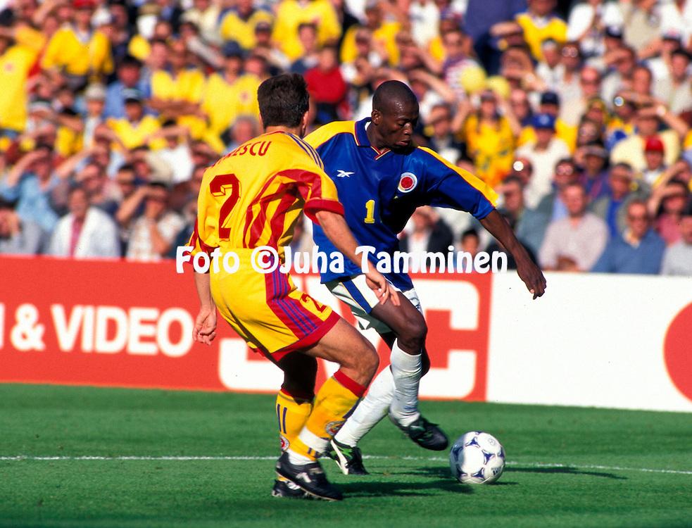 FIFA World Cup - France 1998<br /> 15.6.1998, Stade Gerland, Lyon, France.<br /> Group G, Romania v Colombia.<br /> Faustino Asprilla (Colombia) v Dan Petrescu (Romania).