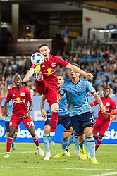 July 8, 2018 - Bronx, New York, United States - New York Red Bulls midfielder ALEX MUYL (19) jumps to keep the ball in play during a regular season match at Yankee Stadium in Bronx, NY.  New York City FC defeats the New York Red Bulls 1 to 0 (Credit Image: © Mark Smith via ZUMA Wire)