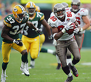 GREEN BAY, WI - SEPTEMBER 25:  Wide receiver Michael Clayton #80 of the Tampa Bay Buccaneers gains yardage in the open field while chased by cornerback Mike Hawkins #37 of the Green Bay Packers after a pass reception at Lambeau Field on September 25, 2005 in Green Bay, Wisconsin. The Buccaneers defeated the Packers 17-16. ©Paul Anthony Spinelli *** Local Caption *** Michael Clayton;Mike Hawkins