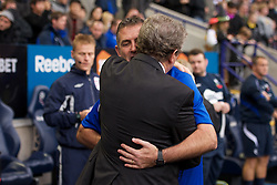 BOLTON, ENGLAND - Sunday, October 31, 2010: Liverpool's manager Roy Hodgson and Bolton Wanderers' manager Owen Coyle before the Premiership match at the Reebok Stadium. (Pic by: David Rawcliffe/Propaganda)