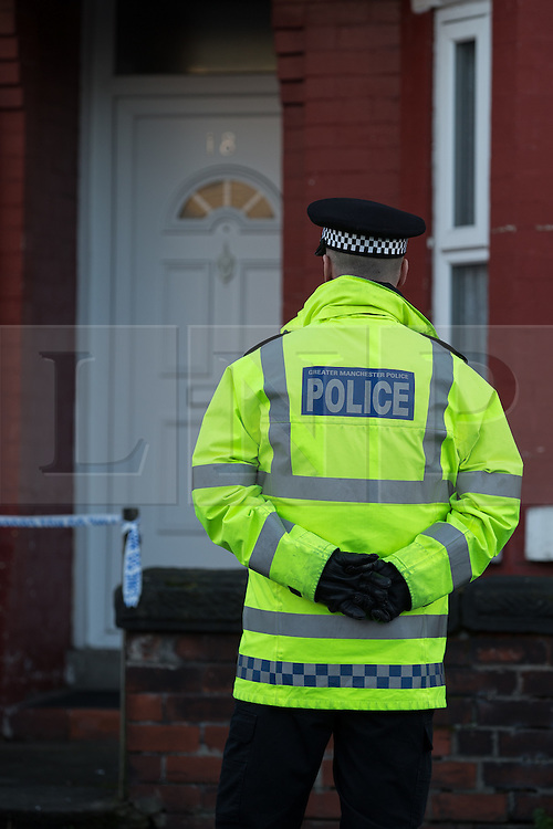 © Licensed to London News Pictures . FILE PICTURE DATED 22/11/2013 of police and forensic scenes of crime investigators at 18 Mayford Road , Levenshulme , Manchester , UK , where the body of 49 year old mother of four , Aisha Alam , was discovered stabbed to death as today (Monday 30th June 2014) Aisha's husband , Aftab Alam , has been sentenced to life in prison with a minimum of 12 years for her murder . Aftab and Aisha had been married for 29 years, but a few years ago the marriage began to deteriorate . Aisha reported domestic violence by Aftab in 2011 but did not want police to prosecute . Shortly after this , Aftab left the family home . Aftab subsequently returned to the family home , but the relationship was tempestuous . On the morning of Friday 22 November 2013 Aftab Alam drove to Longsight Police Station and told police he had killed his wife . Police attended the family home and found Aisha , a mother of four , lifeless on the couch in her home . Aftab Alam had launched an unprovoked attack , stabbing her multiple times in the chest , neck and back , killing her . Photo credit : Joel Goodman/LNP