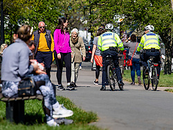 © Licensed to London News Pictures. 15/04/2020. London, UK. Police cyclists patrol Primrose Hill in North London as members of the public go out in the sunshine to exercise as Ministers decide when and how the lockdown will finish as politicians are warned that the UK could face the worst recession in 300 years. Photo credit: Alex Lentati/LNP