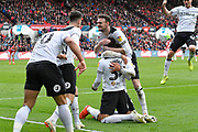 Goal - Jayden Bogle (37) of Derby County is mobbed as he celebrates scoring a goal to give a 0-2 lead to the away team during the EFL Sky Bet Championship match between Bristol City and Derby County at Ashton Gate, Bristol, England on 27 April 2019.