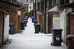 © Licensed to London News Pictures . 09/11/2013 . Manchester , UK . Back streets behind terraced houses in Salford covered in a blanket of hail stones . A freak hail storm in Manchester covers the streets with large hailstones as loud rolling thunder is heard . Photo credit : Joel Goodman/LNP