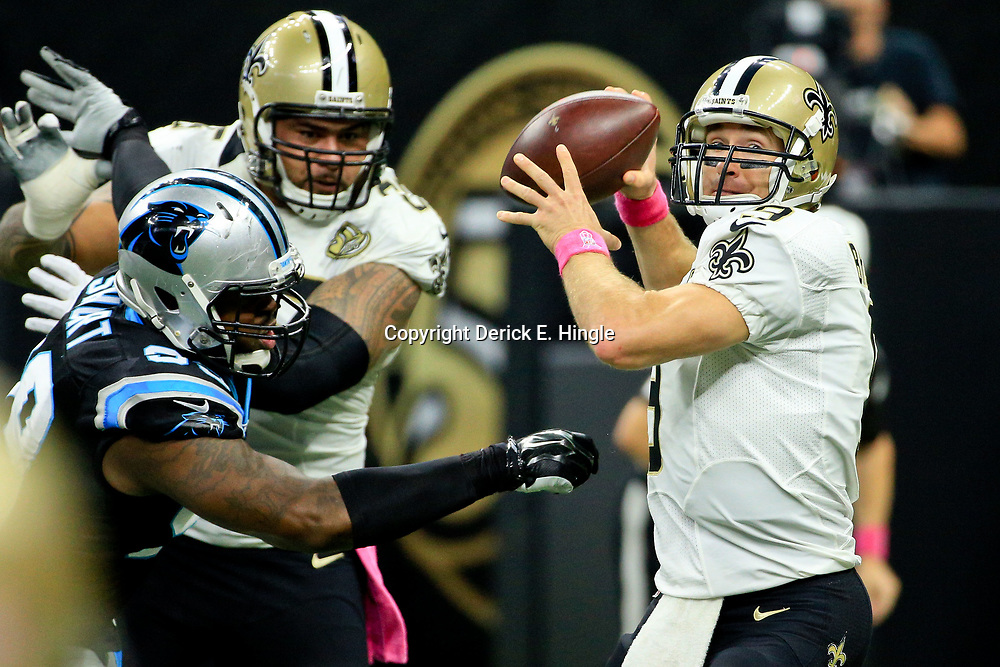 Oct 16, 2016; New Orleans, LA, USA; New Orleans Saints quarterback Drew Brees (9) throws as Carolina Panthers defensive tackle Kawann Short (99) pressures during the first quarter of a game at the Mercedes-Benz Superdome. Mandatory Credit: Derick E. Hingle-USA TODAY Sports