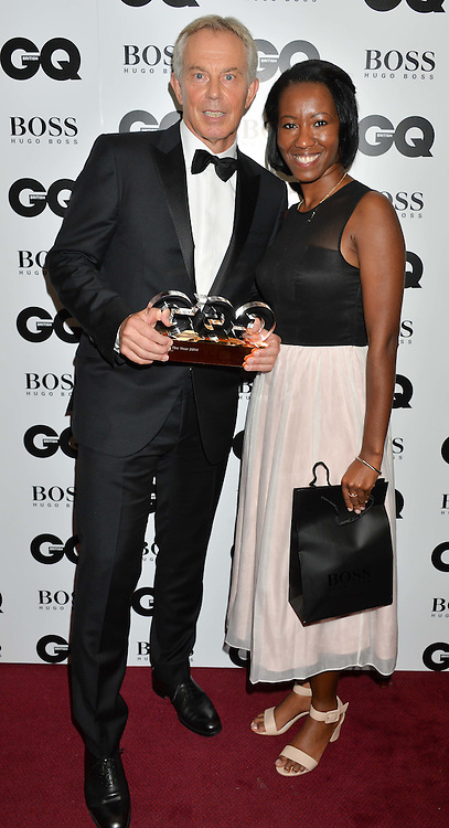Left to right, TONY BLAIR winner of the Philanthropist Award and BANKE ADETAYO at the GQ Men Of The Year 2014 Awards in association with Hugo Boss held at The Royal Opera House, London on 2nd September 2014.