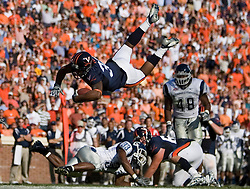 Virginia running back Keith Payne (32) leaps for extra yardage near the end zone.  The Virginia Cavaliers defeated the Connecticut Huskies 17-16 at Scott Stadium in Charlottesville, VA on October 13, 2007