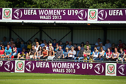 HAVERFORDWEST, WALES - Sunday, August 25, 2013: Spectators watch as Wales take on France during the Group A match of the UEFA Women's Under-19 Championship Wales 2013 tournament at the Bridge Meadow Stadium. (Pic by David Rawcliffe/Propaganda)