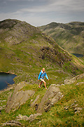 Walking above Coppermines Valley, near Low water tarn, on Coniston Old Man, Lake District, Cumbria, UK