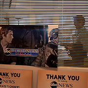 "August 29, 2014 - New York, NY : David Muir, whose silhouette is visible in the background, is taking over for Diane Sawyer as anchor of ABC's ""World News Tonight."" The program, a poster of which is visible in the foreground, will be renamed from ""ABC World News With Diane Sawyer"" to ""ABC World News With David Muir."" CREDIT: Karsten Moran for The New York Times"