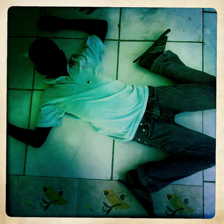 A boy at the Corail camp on Friday, April 6, 2012 in Port-au-Prince, Haiti.