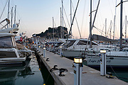 Boats and sailboats at the harbour of Denia and Castle in the background, Denia, Alicante province, Valencia Community, Spain