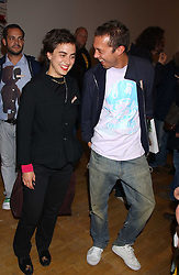 CHIARA BERSI SERLINI and VISCOUNT MACMILLAN at an opening party for artist Paul McCarthy's exhibition 'LaLa Land Parody Paradise' held at the Whitechapel Gallery, 80-82 Whitechapel High Street, London E1 on 22nd October 2005.<br />