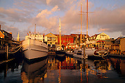 USA, Newport, RI - Boats resting at the Bowen's wharf dock in the late afternoon light.