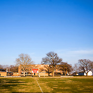 A cold early spring day has the students inside for the day as the muddy football field sits empty at Waterman High School in Waterman, IL.