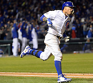 CHICAGO, IL - OCTOBER 7:  Javier Baez #9 the Chicago Cubs runs the bases after hitting a solo, game winning home run in the eighth inning during Game 1 of NLDS against the San Francisco Giants at Wrigley Field on Friday, October 7, 2016 in Chicago, Illinois. (Photo by Ron Vesely/MLB Photos via Getty Images) *** Local Caption *** Javier Baez