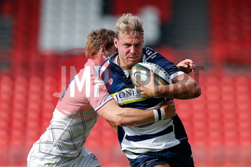 Bristol Rugby Number 8 Mitch Eadie is tackled by Rotherham Titans Winger Ben Rath - Mandatory byline: Rogan Thomson/JMP - 07966 386802 - 04/10/2015 - RUGBY UNION - Ashton Gate Stadium - Bristol, England - Bristol Rugby v Rotherham Titans - Greene King IPA Championship.
