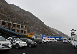 60823769  <br /> Vehicles wait at the entrance after a gas explosion occurred at the Baiyanggou coal mine in Hutubi County in the Hui Autonomous Prefecture of Changji, northwest China s Xinjiang Uygur Autonomous Region, Dec. 13, 2013.Twenty-two were trapped in the coal mine following a gas explosion occurred early Friday, when 34 miners were working underground. Twelve workers managed to escape themselves, Friday, 13th December 2013. Picture by  imago / i-Images<br /> UK ONLY