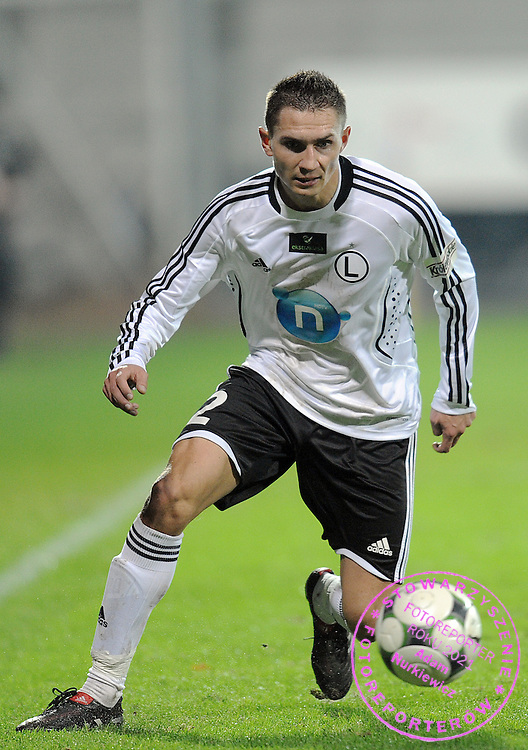ARTUR JEDRZEJCZYK (LEGIA) CONTROLS THE BALL DURING EXTRALEAGUE SOCCER MATCH BETWEEN LEGIA WARSAW AND POLONIA WARSAW DURING 14. ROUND SEASON 2009/2010...WARSAW , POLAND , NOVEMBER 20, 2009..( PHOTO BY ADAM NURKIEWICZ / MEDIASPORT )