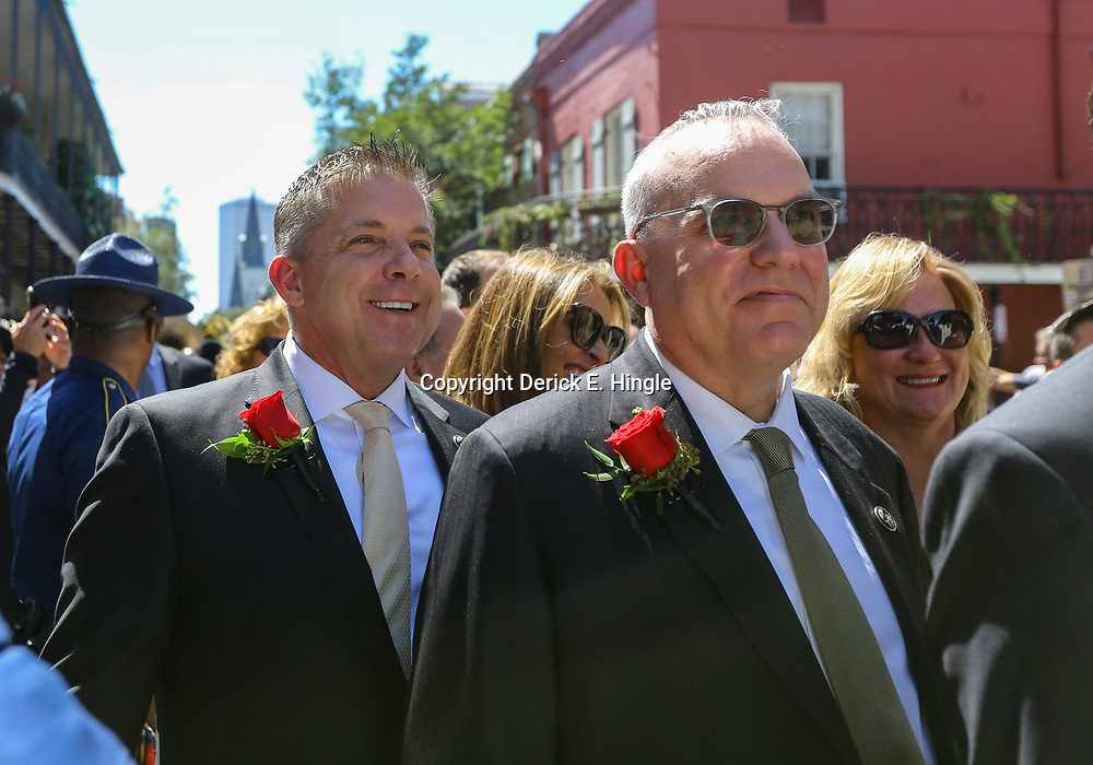 New Orleans Saints head coach Sean Payton and Saints Vice President of Sale Mike Stanfield walk in a second line following the funeral service for NFL New Orleans Saints owner and NBA New Orleans Pelicans owner Tom Benson in New Orleans, Friday, March 23, 2018. Benson died last Thursday at the age of 90. (AP Photo/Derick Hingle)