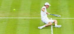 LONDON, ENGLAND - Monday, June 23, 2014: Tomas Berdych (CZE) slips during the Gentlemen's Singles 1st Round match on day one of the Wimbledon Lawn Tennis Championships at the All England Lawn Tennis and Croquet Club. (Pic by David Rawcliffe/Propaganda)