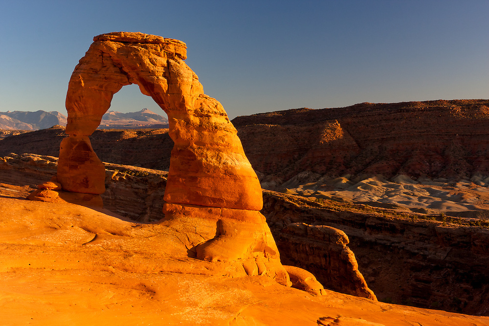 Late afternoon light bathes the symbol of Arches National Park, and of the state of Utah: Delicate Arch