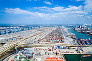 Nederland, Zuid-Holland, Rotterdam, 10-06-2015; Europaweg met zicht op ECT Deltaterminal en Amazonehaven (rechts). Links de Europahaven met APM Terminals.<br /> Containers terminals APM and ECT on Maasvlakte, Port of Rotterdam.<br /> luchtfoto (toeslag op standard tarieven);<br /> aerial photo (additional fee required);<br /> copyright foto/photo Siebe Swart