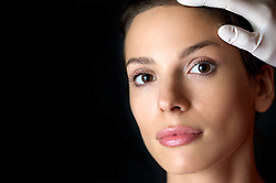 Close up of a woman's face during a cosmetic examination