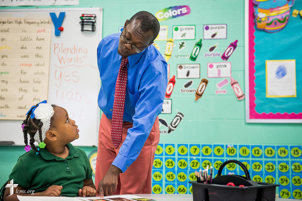 Teacher Jonathan Clausell reads with Ziah Brown at Trinity Evangelical Lutheran School on Monday, April 7, 2014, in Mobile, Ala. LCMS Communications/Erik M. Lunsford