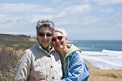 Two Woman embracing  while at the beach in Montauk, NY