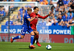 LEICESTER, ENGLAND - Saturday, September 1, 2018: Leicester City's Marc Albrighton and Liverpool's Virgil van Dijk during the FA Premier League match between Leicester City and Liverpool at the King Power Stadium. (Pic by David Rawcliffe/Propaganda)