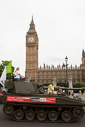 © under license to London News Pictures. 25/06/12. London, UK. Arms control campaigners take armoured tank through the streets of London to call for tough arms trade treaty. The campaign has been supported by Sunday Times photographer Paul Conroy...ALEX CHRISTOFIDES/LNP