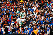 James Tavernier (C) of Rangers FC is sandwiched between Michael Johnston & Jonny Hayes during the Ladbrokes Scottish Premiership match between Rangers and Celtic at Ibrox, Glasgow, Scotland on 12 May 2019.