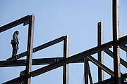 ironworker standing on top of a steel framework