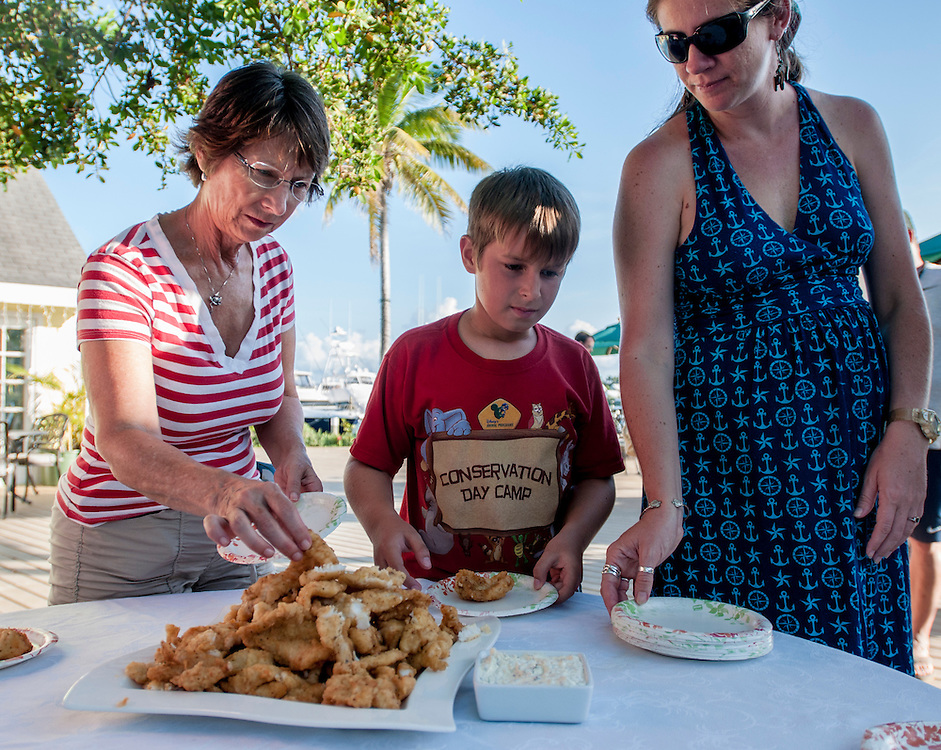 Patrons of a lionfish derby get a taste. Lionfish are considered very good eating and are guilt-free for those refusing to eat other seafoods that are caught in unsustainable fisheries.