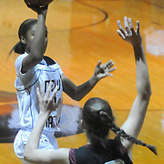 New Hanover's Taylor Perkins shoots over Ashley's Dana Craig Friday December 19, 2014 at New Hanover High School in Wilmington, N.C. (Jason A. Frizzelle)