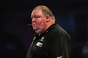John Henderson with a dart in his mouth during the World Darts Championships 2018 at Alexandra Palace, London, United Kingdom on 27 December 2018.