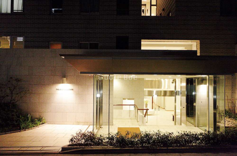 modern glass entrance to apartment complex