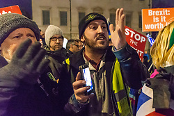 """James Goddard, a pro-Brexit campaigner argues with pro-Remain campaigners as they disembark a bus emblazoned with """"Bollox to Brexit"""" as it arrives at Steve Bray's ongoing pro-remain protest at Old Palace Yard outside Parliament. Westminster, London, December 20 2018."""