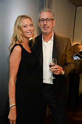 An exclusive preview of the new Samsung OLED Curved TV has hosted by Nick & Holly Candy at their home at One Hyde Park, London on 29th August 2013.<br /> Picture shows:-Eric Watson, Lisa Henrekson.