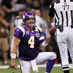 September 9, 2010; New Orleans, LA, USA;  Minnesota Vikings quarterback Brett Favre (4) tosses the ball toreferee Terry McAulay (77) following a sack by the New Orleans Saints during the third quarter of the NFL Kickoff season opener at the Louisiana Superdome. Mandatory Credit: Derick E. Hingle