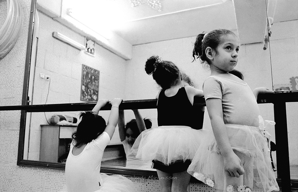 Little Iranian girls in tutu during balletclass. Forbidden since the Islamic revolution, these classes are private and highly secret. Tehran, Iran, 2007