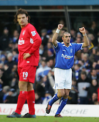 BIRMINGHAM, ENGLAND - SATURDAY FEBRUARY 12th 2005:   Liverpool's Fernando Morientes looks dejected as Birmingham's Walter Pandiani celebrates the opening goal during the Premiership match at St. Andrews (Pic by David Rawcliffe/Propaganda)