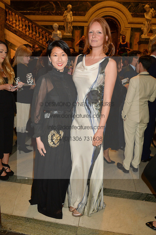 Left to right, BEATRIX ONG and OLIVIA ING at the LDNY Fashion Show and WIE Award Gala sponsored by Maserati held at The Goldsmith's Hall, Foster Lane, City of London on 27th April 2015.